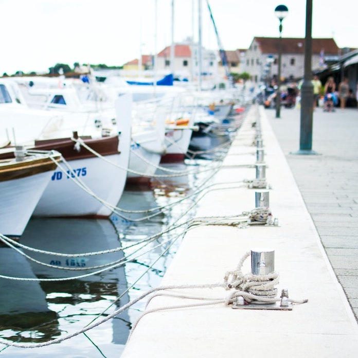 boats moored on a jetty