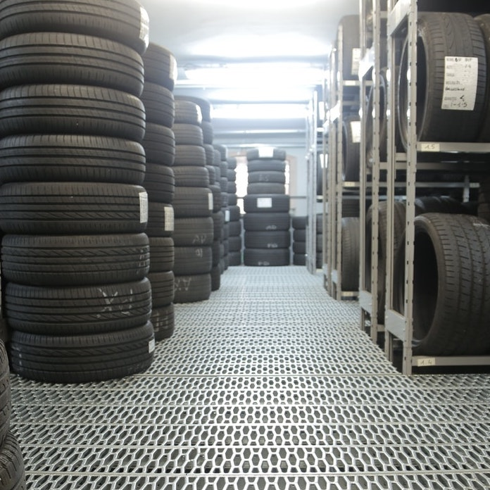 tyres stacked on steel frames