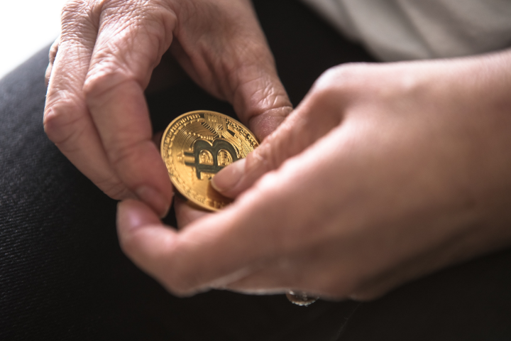 woman holding bitcoin in her hands